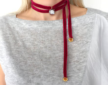 Plush ruby velvet choker, featuring a beautiful engraved skull in a sardonix seashell cameo