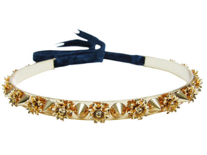 Dipped in gold Holly metal choker is embellished with spikes and flowers. Fastens at the back with a luxurious velvet ribbon.