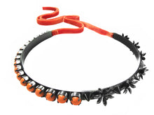 Jasmine choker in a beautiful hematite finish, embellished with flowers, spikes and coral Swarovski pearls. Fastest at the back with a luxurious velvet ribbon in a vibrant orange.