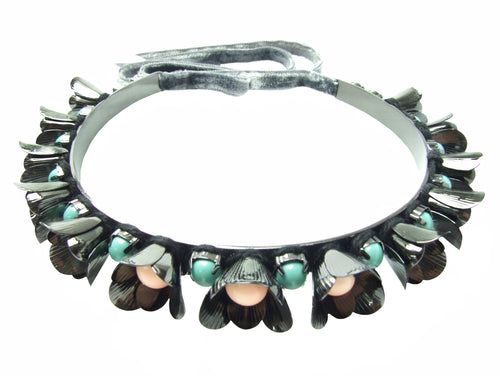 With beautiful dark finish in hematite, metal Lilly choker is embellished with flowers and pastel coloured Swarovski pearls. The choker fastens at the back with a luxurious velvet ribbon.
