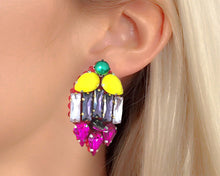 Shaped with colourful yellow, purple and fuchsia pink crystals, Mia statement earrings featuring a lustrous faux pearl at the top.