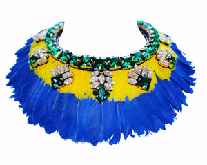 Make an entrance with Paloma necklace by Jolita Jewellery. Handmade with layers of vibrant yellow and cobalt blue feathers and embellished with light-catching clear and emerald green crystals.