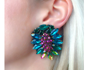 Penelope earrings are delicately shaped with clusters of turquoise and green rhinestones. The centre stone is embellished with fuchsia iridescent crystals. Made for pierced ears.