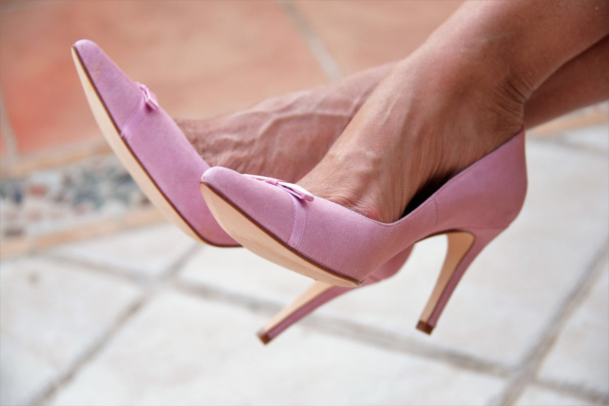 Pink heels with satin bow by Lola Domecq