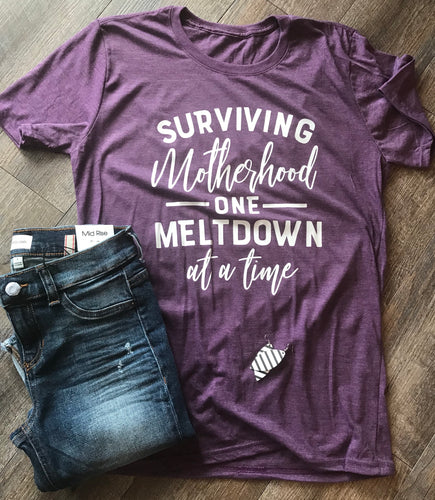 Surviving motherhood one meltdown at a time funny mom life tee - Mavictoria Designs Hot Press Express