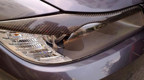 BMW E90 real carbon headlight eyelids