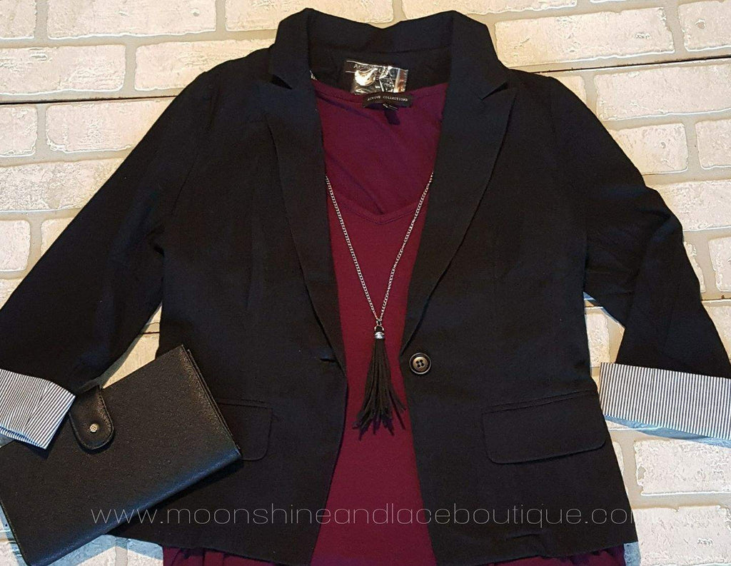 Black fitted jacket with pin stripped cuffs