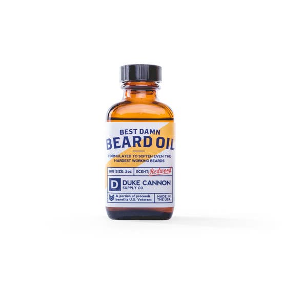 "There is a fine line between the unruly beard of a grizzled mountain hobo and the dashing beard of a world champion. Go from unkempt to ""kempt"" with Duke Cannon's Best Damn Beard Oil. Made with premium natural ingredients such as Apricot kernel, argan, and jojoba oils, it's formulated to soften even the hardest working beards. Features the scent of freshly split cedar, making you feel like you're on a walk through the Redwoods."