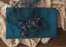 limited-edition teal velvet bows OR Teal DreamSoft wrap OR backdrop ($22/25/15/37)