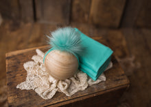 limited-edition pom band OR Seafoam DreamSoft wrap OR backdrop ($20/15/37)