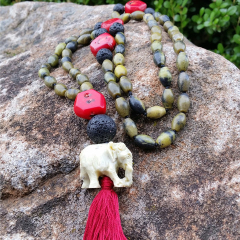 Essential oil diffuser necklace - knotted yellow turquoise, red coral - mala - elephant amulet and tassle