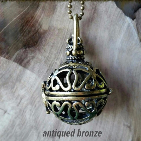 Essential oil diffuser necklace - bola, cage, antiqued bronze