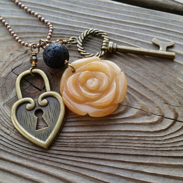 Essential oil essential oil diffuser necklace - cluster - antiqued bronz  - red agate flower, skeleton key, heart lock.