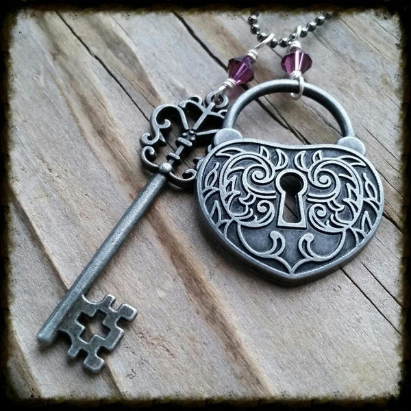 Essential oil diffuser necklace-cluster-skeleton key-heart- lock- Swarovski Crystal- antiqued silver