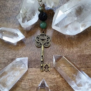 Essential oil diffuser necklace- skeleton key -scroll