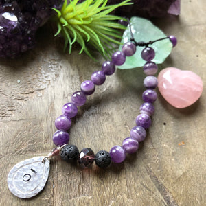 Hand stamped essential oil diffuser bracelet- amethyst with drop charm