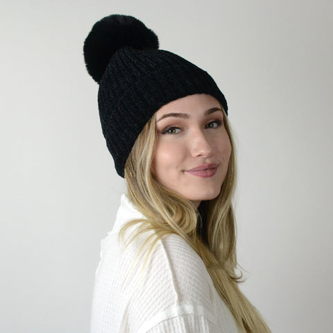Solid Knit Black Pom Hat. This adorable Solid Knit Black Pom Hat will keep you warm through all the winter weather. Featuring the softest and coziest material, lined on the inside for extra warmth and the cutest pom pom. This hat makes the perfect gift for family or friends, or even for yourself!