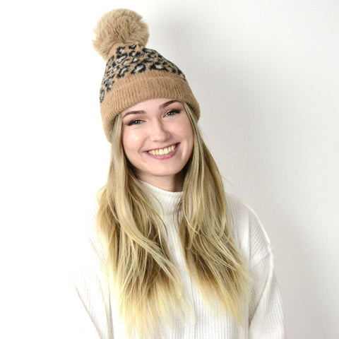 Leopard Pom Hat. Bundle up while looking so cute in this adorable Leopard Pom Hat! Featuring a sweet leopard print on a soft and cozy pom hat. Add an adorable touch of softness to any outfit!
