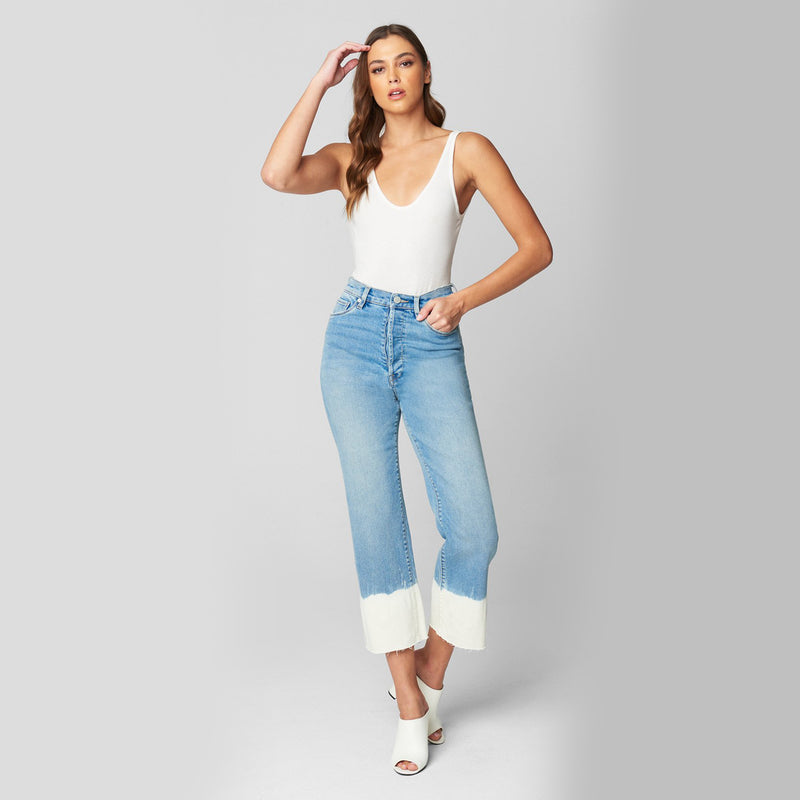 Blank NYC Baxter High Waisted Bleach Hem Jeans. Steal all the stares in this must-have jeans! Featuring a high waisted fit, front and back pocket details, light-wash denim material, and a fun dipped bleach hem. Pair with a white bodysuit and white sandals for the coolest look.