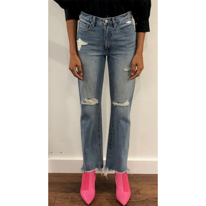 Blue Revival Organic Boyfriend Jean. Choose both comfort and style with these must-have jeans! Featuring a boyfriend style, organic blue denim material, high waisted fit, and distressed details. We are loving these paired with a band tee and platform sneakers for a super trendy daytime look.