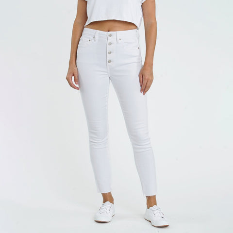 Daze Money Maker High Rise Vintage Skinny Jean. We are loving these fresh jeans for your warmer weather months! Featuring a high rise fit, beautiful white colored denim, skinny fit, button up closure, and a raw hem.