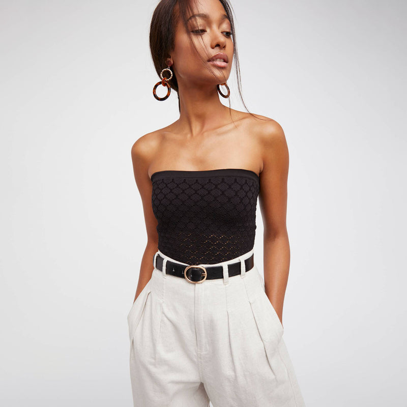 Free People Diamond Seamless Tube Top. Semi-sheer textured tube top with diamond pattern cutouts throughout. Built-in bra. Stretchy, body-conscious fit.