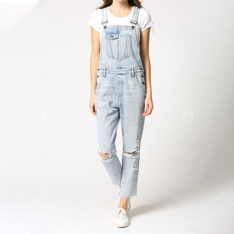 Hidden Dylan Distressed Boyfriend Overalls. These overalls are a true wardrobe staple! Featuring a light wash denim material, boyfriend style, and distressed details. Dress this piece up with a crop top and heels for a killer going-out look, or with sneakers for the perfect daytime fit. We are obsessed!
