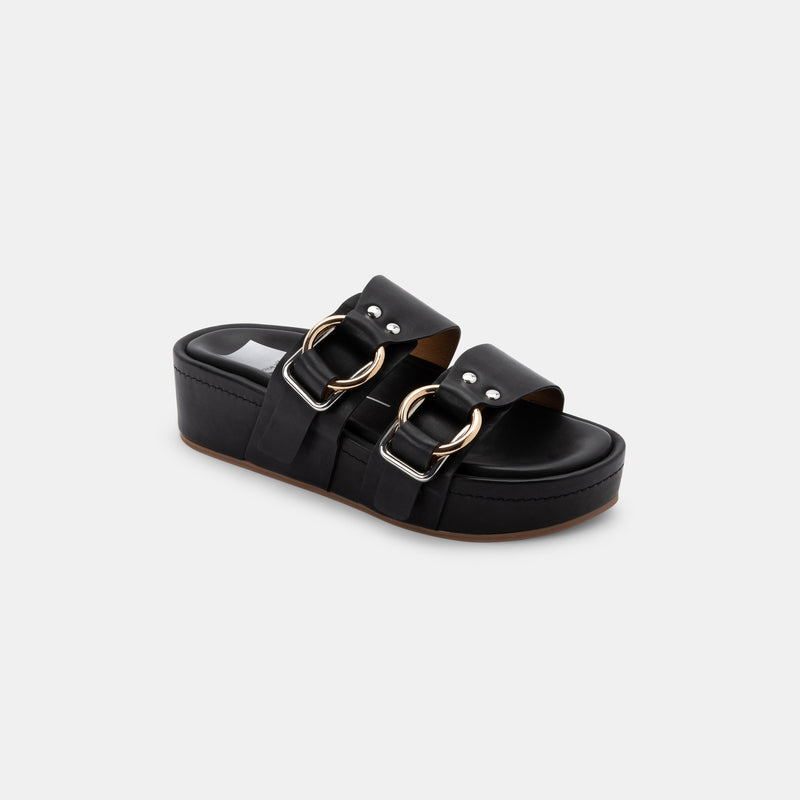 Dolce Vita Cici Flatform Sandal. Nail all the tends this season with our favorite sandal! Featuring a leather material, trendy platform, slide on style, and buckle details. Pair with ripped jeans and a graphic t for a look we are loving!