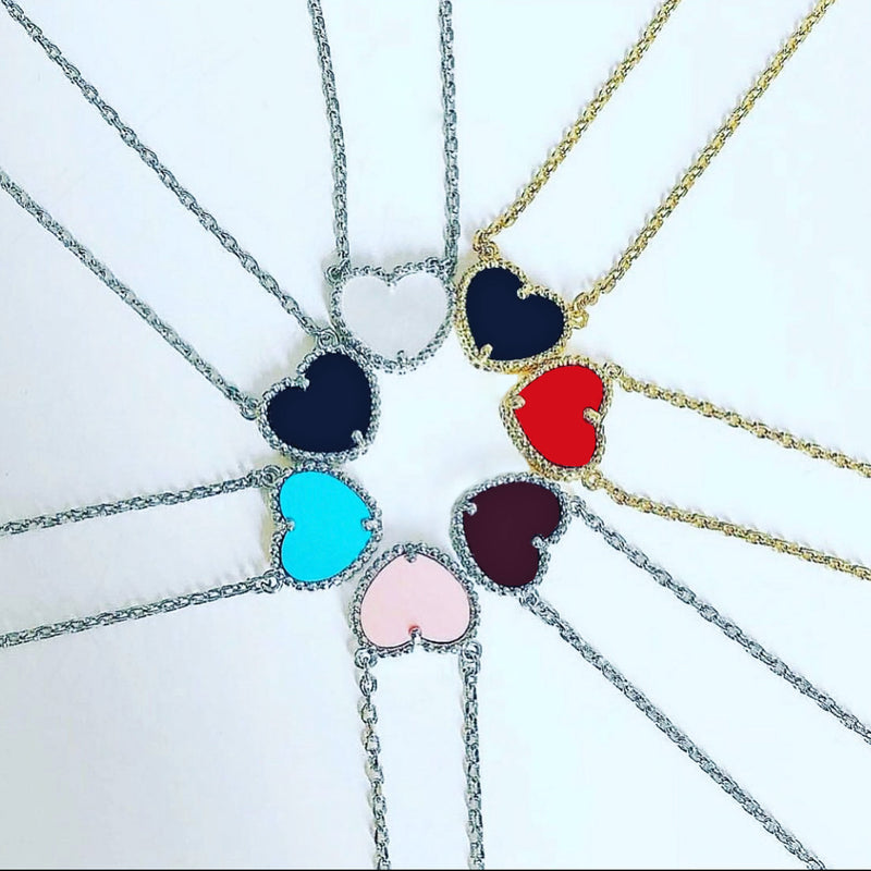 Enamel Heart Necklace. These classic Enamel Heart Necklaces are the perfect accent to any outfit. Pick from an assortment of colors on a gold or silver chain. Simple yet elegant, one of these necklaces is the perfect gift or addition to your jewelry collection.