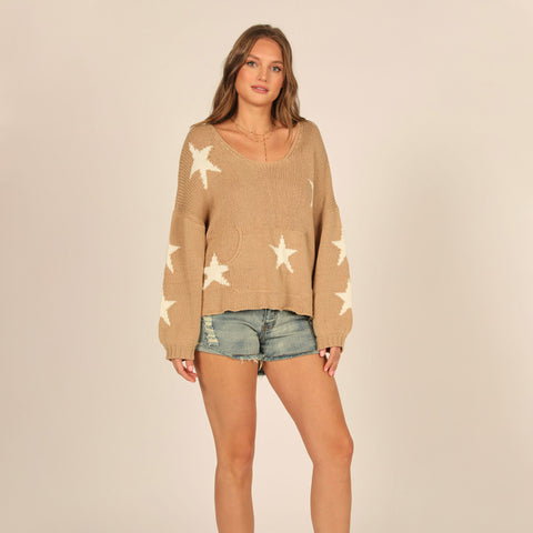 Vintage Havana Star Puff Sleeve Sweater. This sweater is a seasonal essential! Featuring a dreamy stone material with long sleeves, a star design and an oversized fit. Style it with distressed denim and fresh kicks for a look we are loving.