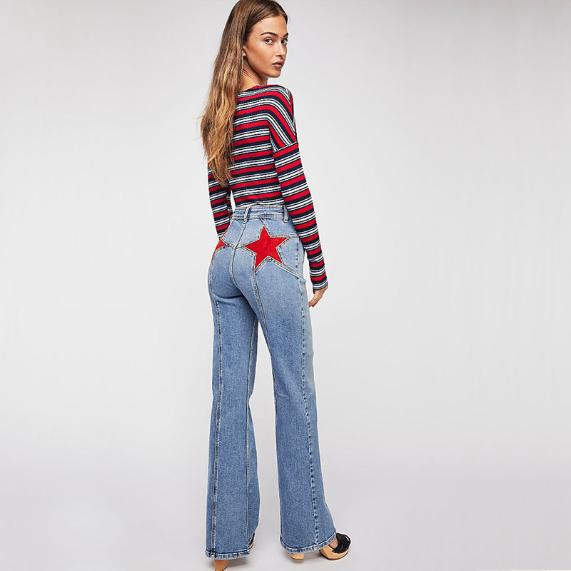 Free People Firecracker Flare Jeans. A need-now novelty from the We The Free collection, these special and star-adorned jeans are the vintage-inspired staple your wardrobe has been missing.