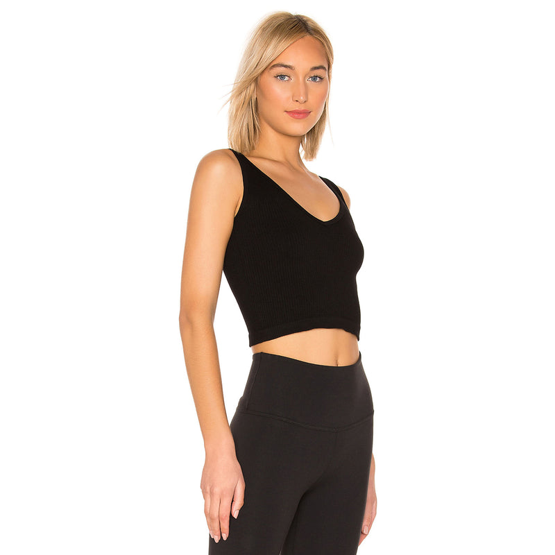 Free People Ribbed Brami. One part cami, one part bra, this ribbed brami is featured in a seamless fabric with a V-neckline. This little tank pairs perfect with your favorite lounge shorts for a chill look, or paired with some high waisted jeans for a cool vibe!