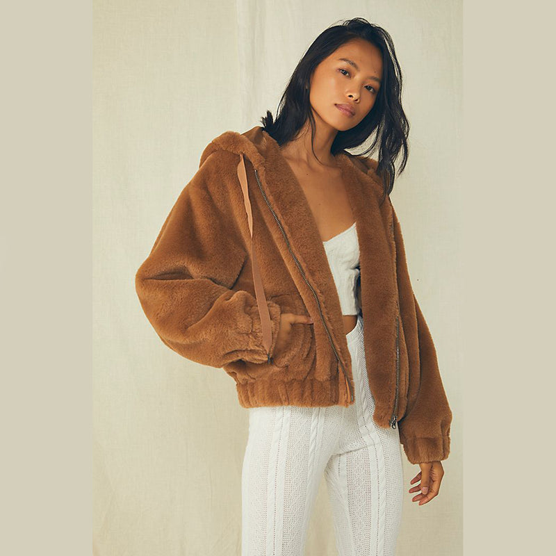 Free People Freya Faux Fur Hoodie. Stand out in this so special hoodie featured in a super luxe faux-fur fabrication and classic zip-front silhouette for added versatility.