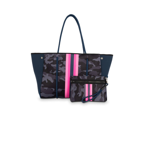 Haute Shore Greyson Epic Tote Bag. We are so in love with this versatile tote bag! Featuring a navy camouflage design with pink and navy stripes, neoprene material, ultra light weight style, removable hard bottom liner, removable wristlet pouch, and adjustable size panels to change shape of bag.