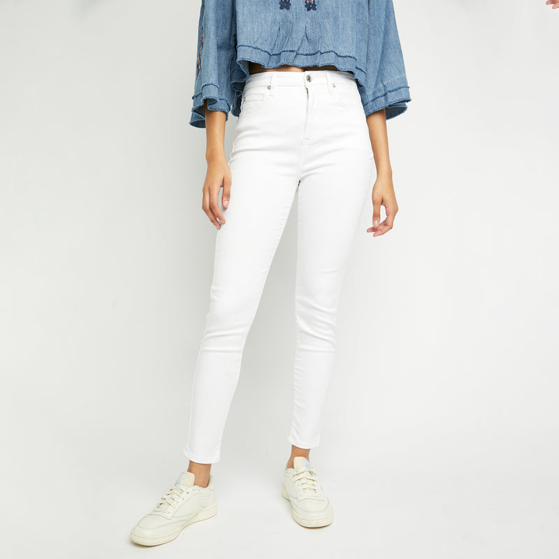 Free People Montana Skinny Lily White. Your new go-to skinnies! These staple midi jeans feature a high-rise silhouette, a semi-stretch denim fabrication for the most flattering, timeless style, button-front closure, five pocket design, and a high rise design. Pair with a floral blouse and wedges for a timeless look.