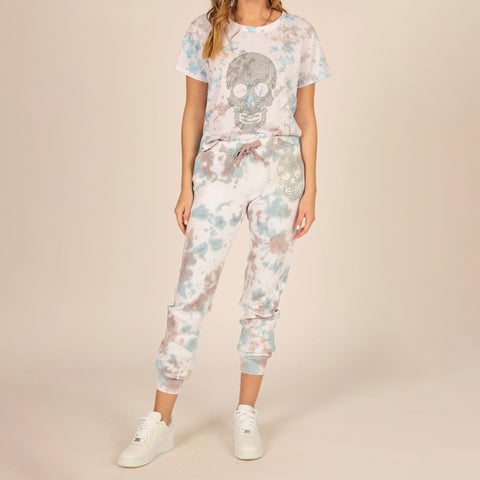 Vintage Havana Tie Dye Burnout Rhinestone Jogger. Add this season's must-have print to your look with these bottoms! Featuring a multi-colored tie dye material with an adjustable jaw string and a comfy fit. Team these with the matching hoodie and fresh kicks to complete the look.