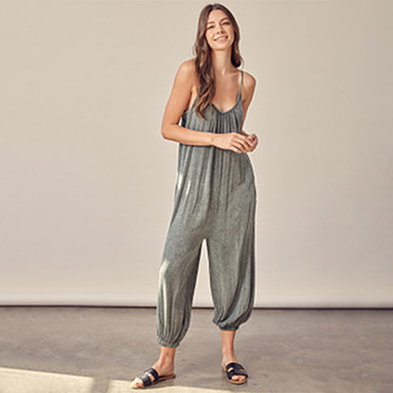 Washed Wide Leg Jumpsuit. This easy piece will be sure to nail a trendy look this season. Featuring a tank style, loose fit, washed color, comfy fabric, and cinched detail at the ankles. We are loving this jumpsuit paired with a belted around the waist, gold jewelry, and lace-up sandals.