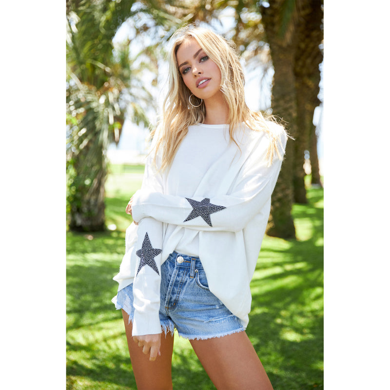 Elan Long Sleeve Star Embellished Sweater. Add some sparkle to your everyday look with this gorgeous sweater! Featuring long sleeves, knit material, round neckline, and star embellished details. Pair this top with denim and booties for a cozy, effortless look!