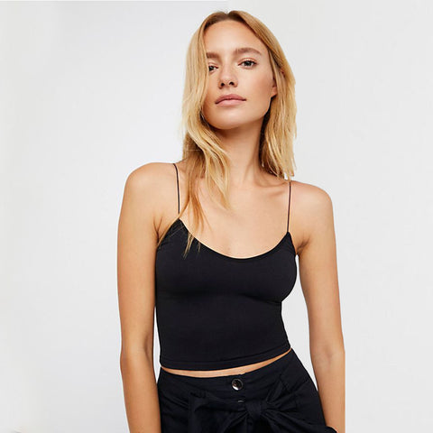 Free People Skinny Strap Brami. American made from our Signature Seamless fabric, this stretchy brami features elastic straps and a ribbed hem. The perfect little tank for lounging or hanging out with friends, this top is essential!
