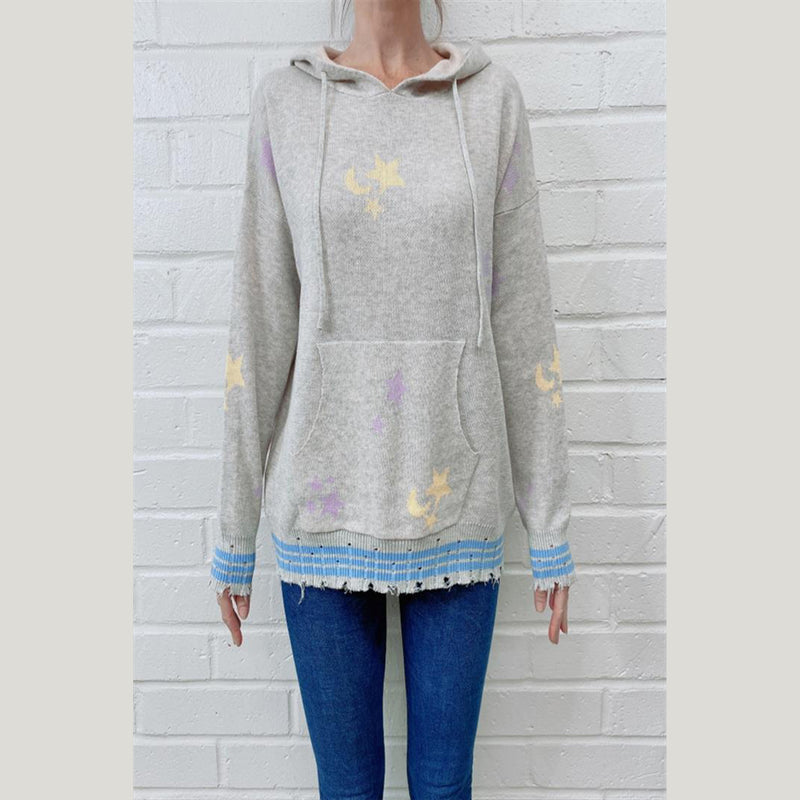 Star Moon Hooded Sweater. Look adorable while staying cozy in this hoodie! Featuring a soft grey material, yellow and purple star and moon details, long sleeves, front pocket, hooded detail, and adjustable jaw-string. Pair with light-wash denim and fun sneakers for the perfect everyday look.