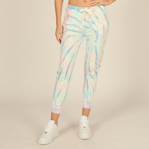 Vintage Havana Tie Dye High Waisted Pocket Jogger. Add this season's must-have print to your look with these comfy bottoms. Featuring a comfy high waisted fit, multi-color tie-dye print, adjustable jaw-string, and cinched detail at the ankle. Pair with the matching tie-dye crewneck and your fave sneakers to complete the look.