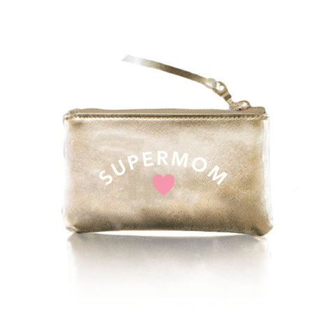 Supermom Vegan Pouch. Perfect for all those super moms out there, this adorable pouch will be sure to put a smile on your face! Featuring a vegan leather material, 'supermom' graphic detail, zipper closure, and a wristlet detail. Use this clutch on it own when you are on-the-go, or even add it to your everyday bag to stay organized!