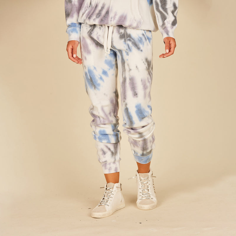 Seaside Tie Dye Burnout Joggers. You'll be dreaming of summer skies and blue ocean waves in these adorable Seaside Tie Dye Burnout Joggers! Featuring blue tones swirled together on soft and cozy joggers. Pair this with out matching crewneck for a complete look, or with your favorite lounge tops!