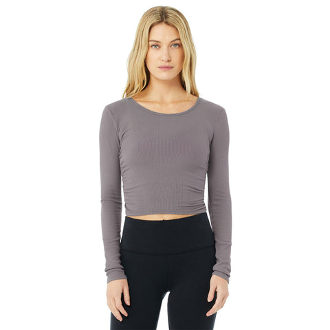 "Alo Gather Long Sleeve Top. Put the ""warm"" in warm-up with the Gather Long Sleeve. It's made with a soft ribbed knit and has a cropped, fitted silhouette and cute cinched sides. Pairs pretty with the 7/8 Airbrush High Waist Leggings."
