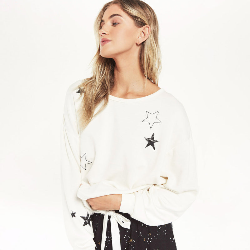 Z Supply Night Owl Starry Sweatshirt. The stars aligned to bring you this ultra soft pullover! Our softest premium fleece knit was used to make the Night Owl Starry Sweatshirt. Featuring a classic oversized crewneck design, with a scattering of printed stars, this pullover will keep you cozy for any cool weather adventures.