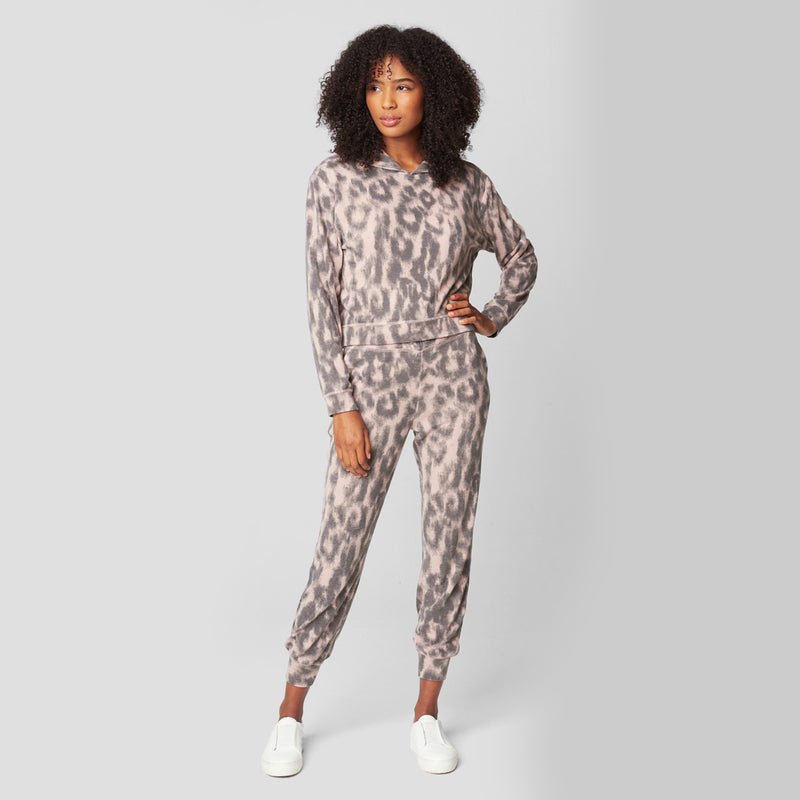 Blank NYC Animal Print Sweatshirt. Get wild with your loungewear collection! This sweatshirt features a pink and black leopard printed material, long sleeves, hooded detail, and a baggy fit. Pair with the matching bottoms for such a trendy, chill look.