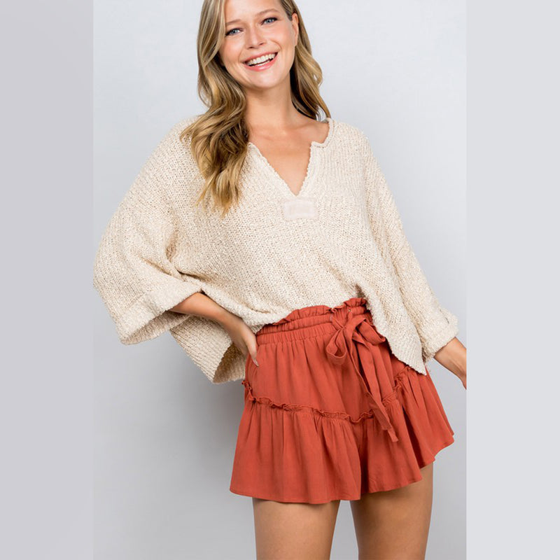 Illa Illa Long Sleeve V-Neck Cropped Sweater. Switch up your top rotation with this super cute piece! Featuring an ultra comfy knitted material, long flared sleeves, v-neck style, and a cropped length. Pair this with some destroyed denim and cute sneakers to complete the look.