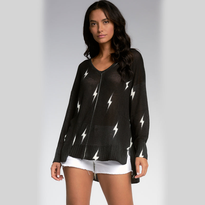 Elan Lighting Bolt Oversized V-Neck Sweater. Amp up your loungewear collection with this fun sweater! Featuring long sleeves, sheer material, lightning bolt details, and an oversized fit, what's not to love?! Pair this piece with boyfriend jeans and platform sneakers for a trendy, everyday look.