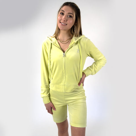 Juicy Couture Candy Green Hoodie. The most iconic comeback of 2021: Juicy Couture! This Velour Hoodie is made of the softest and most luxurious velour and features the classic Juicy logo on the wrist, zipper, and inside collar. Create the most nostalgic matching set by pairing this hoodie with our matching Juicy biker shorts and rock the classic Juicy look everyone will love!