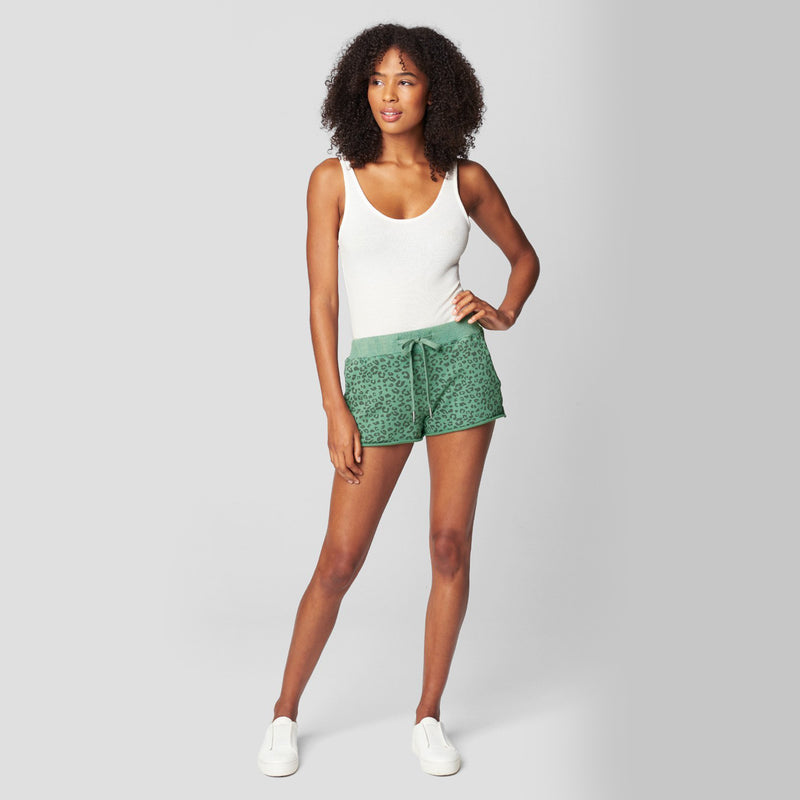 Blank NYC No Cap Leopard Print Shorts. These leopard print shorts are a must-have for your stay at home wardrobe! Featuring a gorgeous green color, leopard print material, adjustable jaw-string detail, and short length. Pair with the matching leopard print sweatshirt for the cutest look.